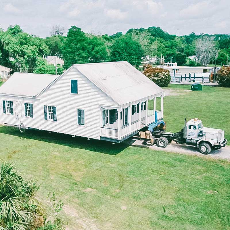 house moving by truck davie shoring on lot