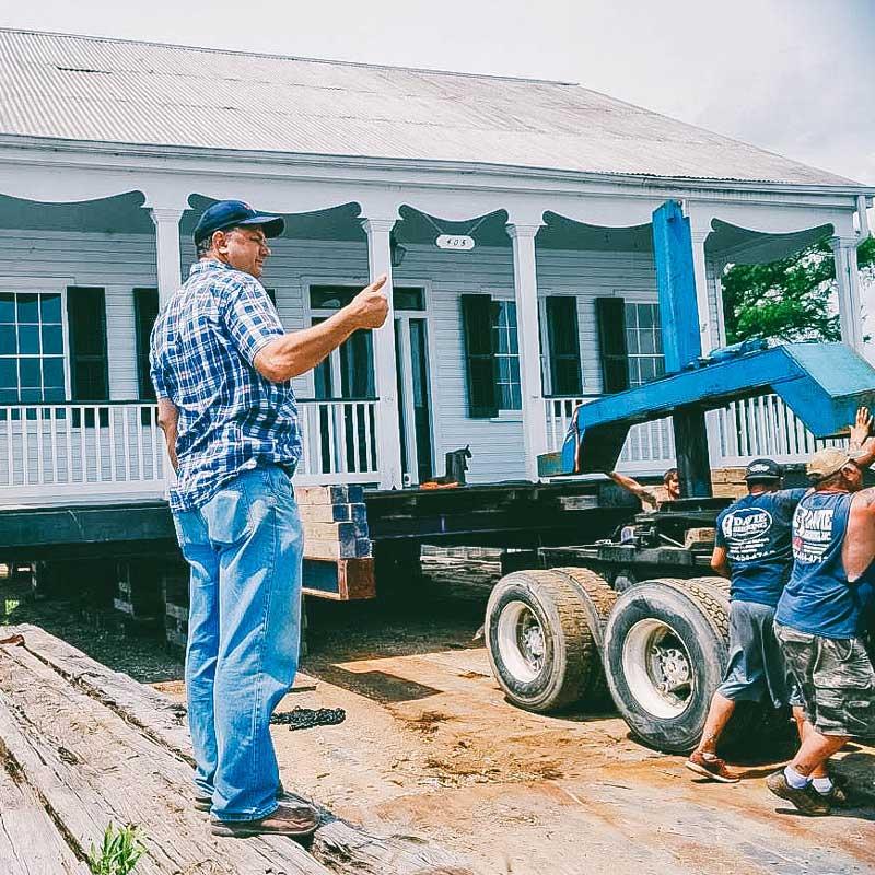 owner davie shoring managing crew moving big house