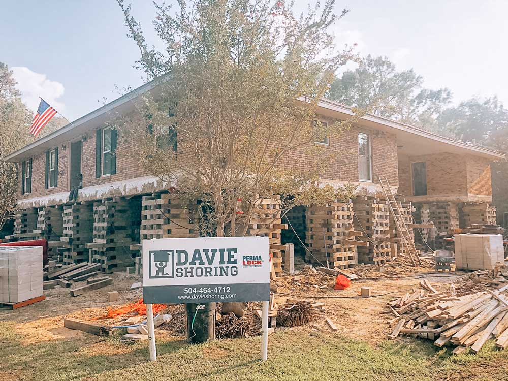 davie shoring sign in front of elevated home