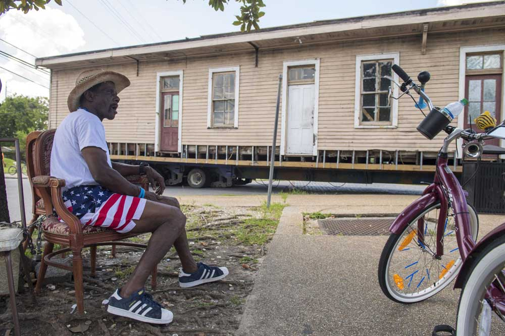 Chris Frazier watches as an 1895 shotgun house is moved from Martin Luther King Blvd. in New Orleans on Wednesday, July 24, 2019.