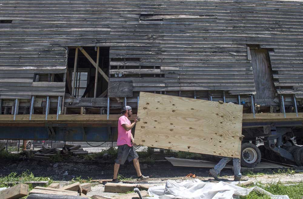 Davie Shoring crewman prepare an 1895 shotgun house to be moved from Martin Luther King Blvd. in New Orleans on Wednesday, July 24, 2019.